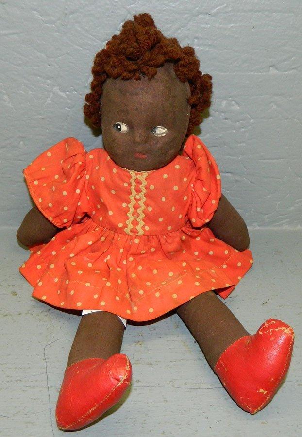 "1: Black folk art rag doll.  13"" long."