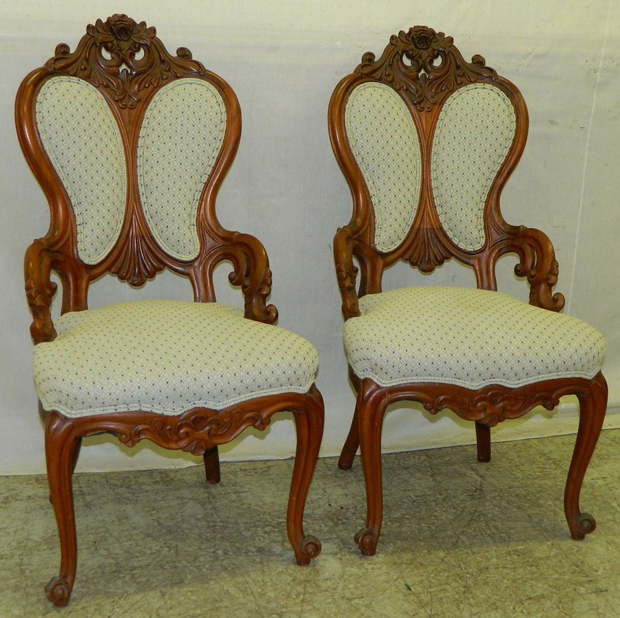 2: Pr. carved rosewood Vict. hip rest side chairs.