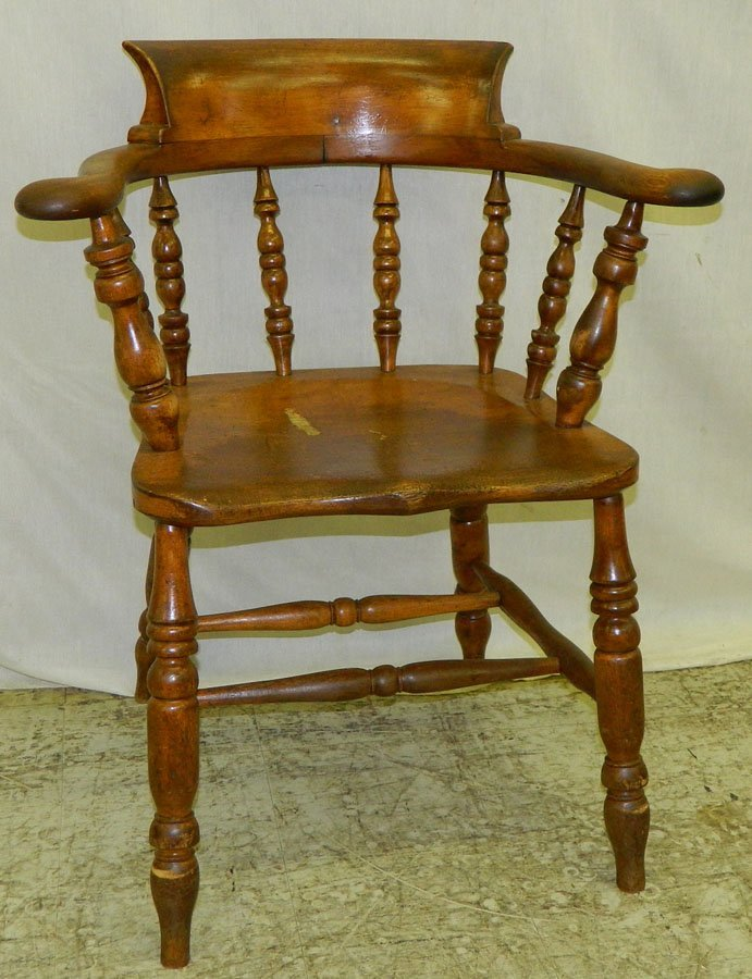 6: 19th century biscuit arm captains chair.