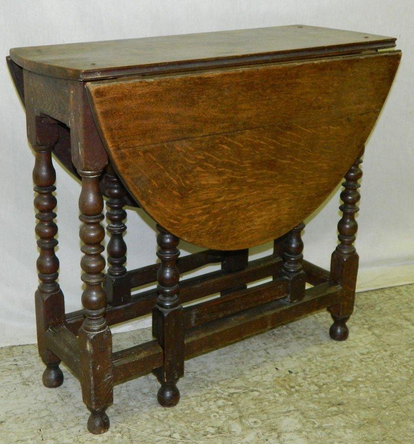 22: 18th c. English oak gate leg table w/drawer.
