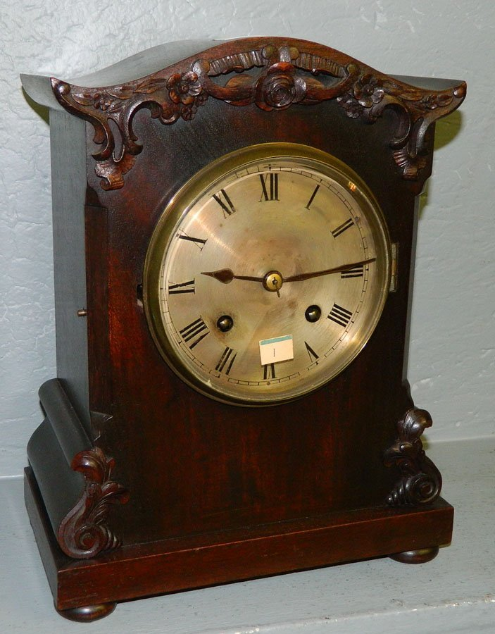 1: 8 day walnut mantle clock w/rosette carving.