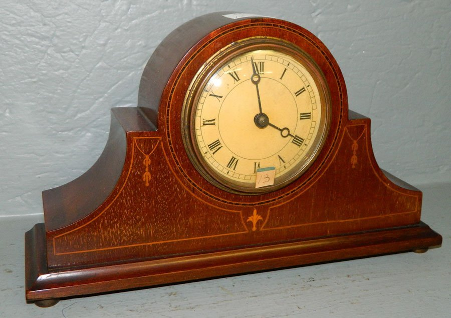 13: 30 hour inlaid mahogany clock w/ arched top.