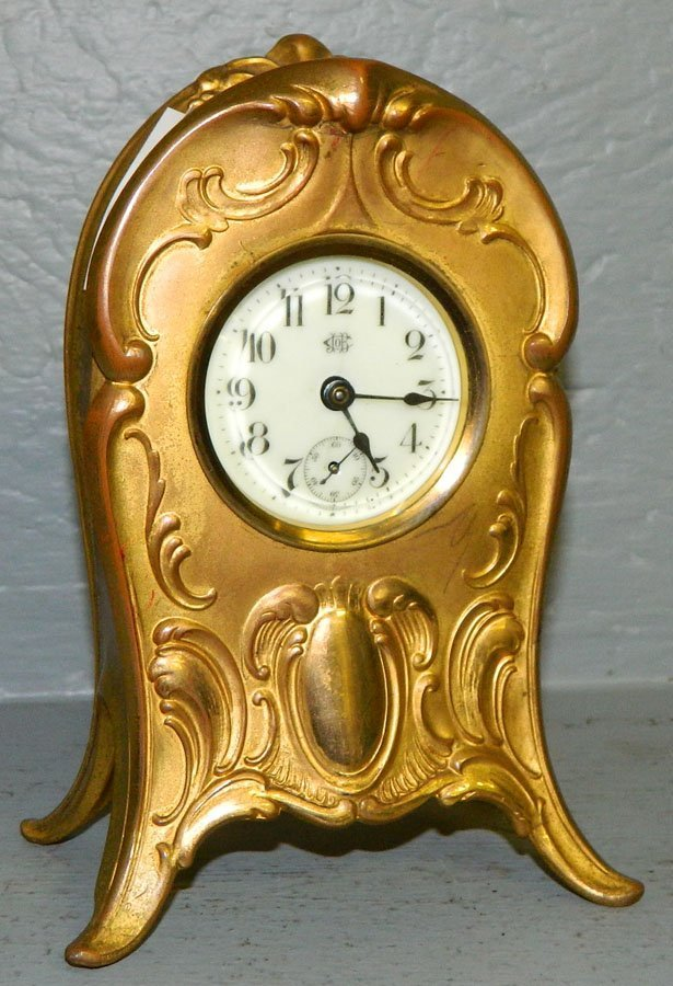 19: Jennings Brothers gilded cast metal case clock.