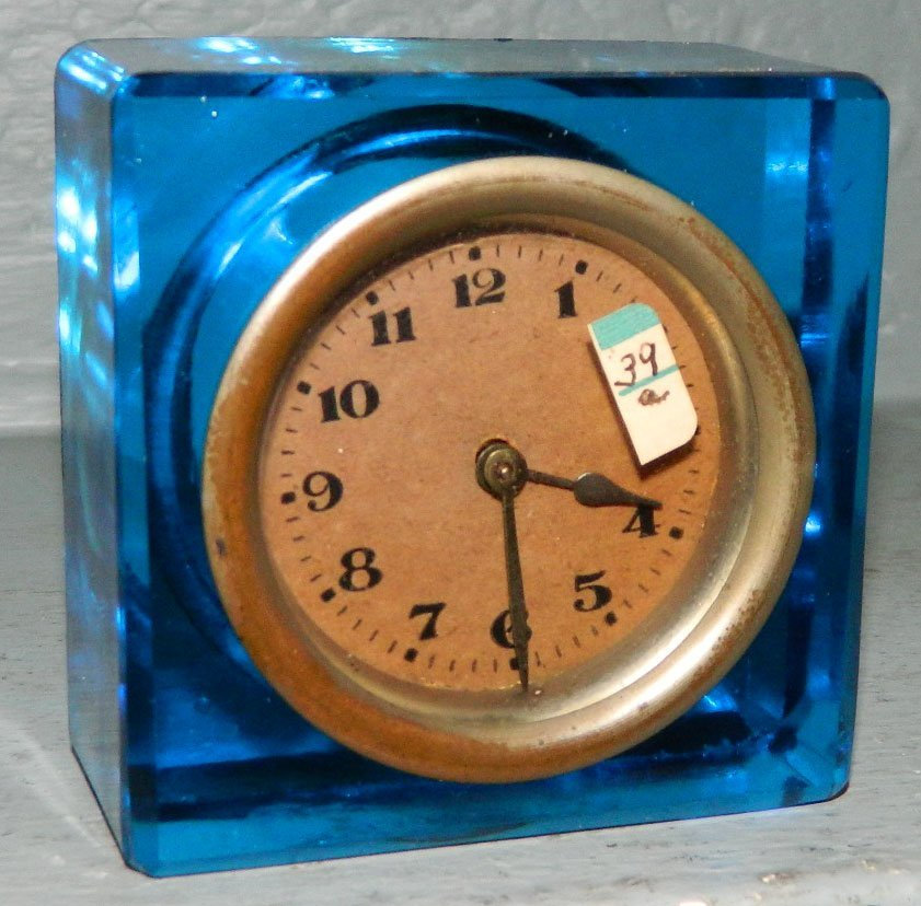 "39A: One day flow blue square clock. 3"" square."