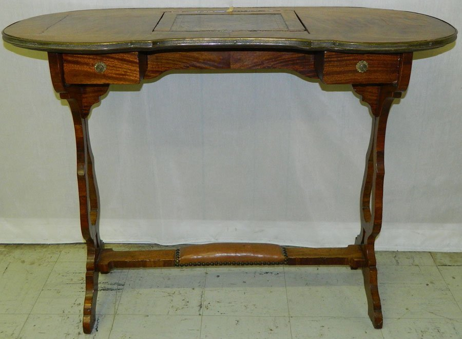 10: Ladies kidney shape leather top French desk.