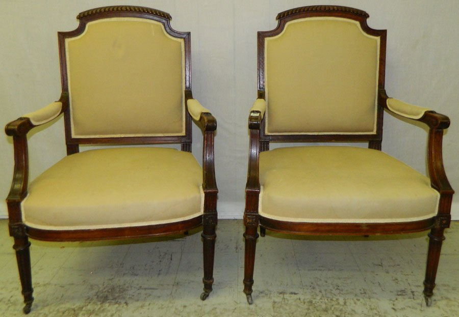 21: Pair French carved fruitwood antique arm chairs.