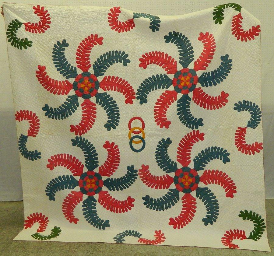 "391: Princes' Feather quilt circa 1860. 72"" x 84""."