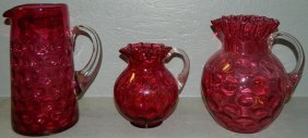 "2: (3) Cranberry pitchers (6 1/4""-9 1/2"" tall)"