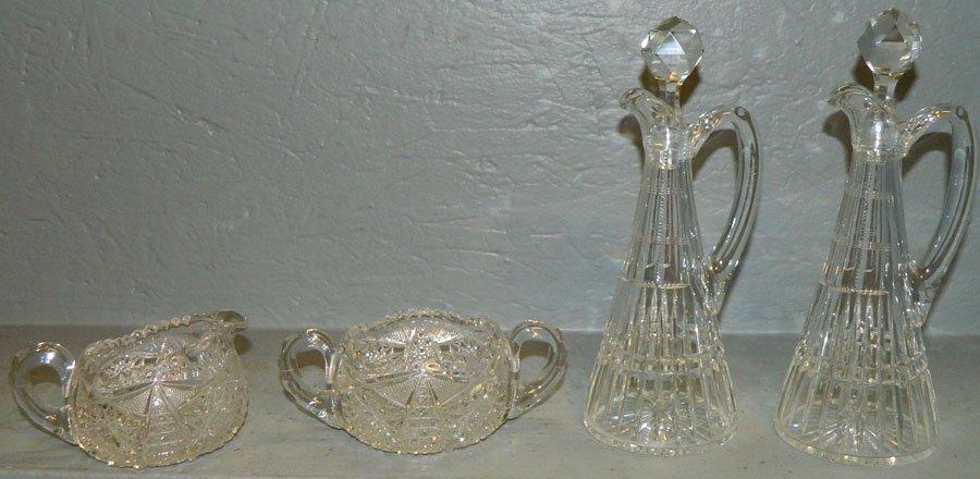 12: Cut creamer and sugar, pair cut glass oil bottles