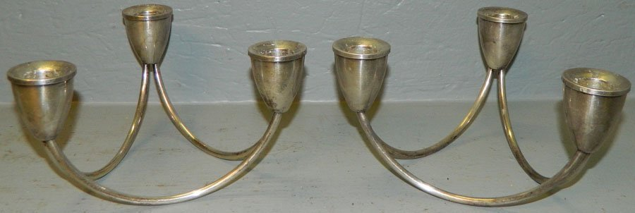 17: Pair weighted sterling candlesticks