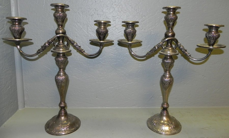 10: Pair of sterling weighted candelabra.
