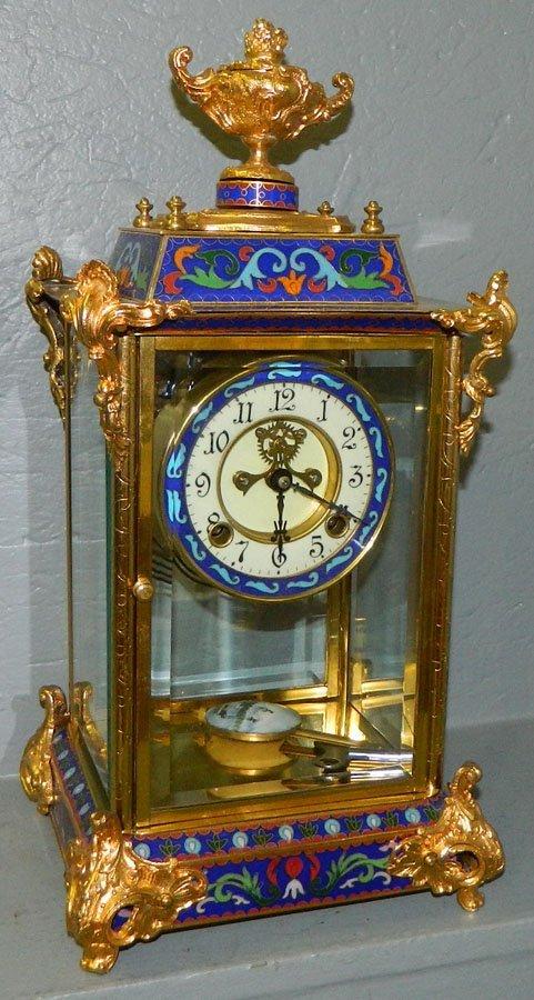 448: Cloisonne and brass regulator.