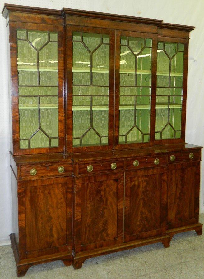 623: Two piece 19th Century mahogany breakfront.
