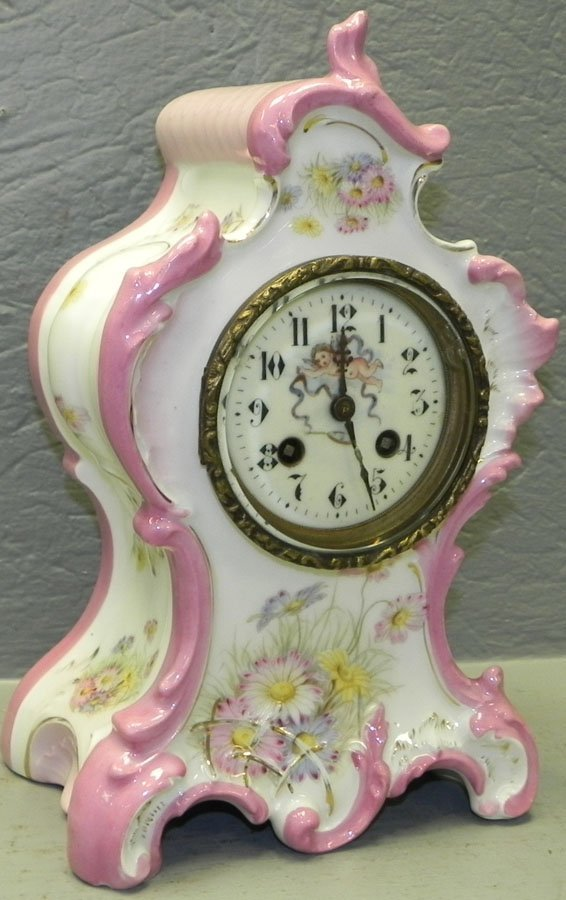 """Porcelain shelf clock. 11 1/2"""" tall."""