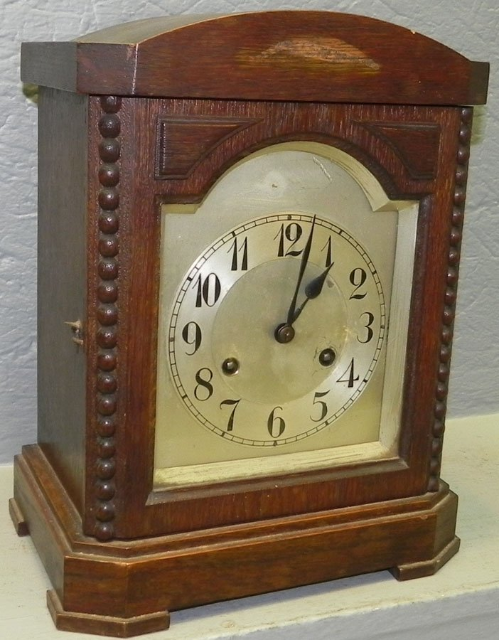 "German shelf clock. 12"" tall."