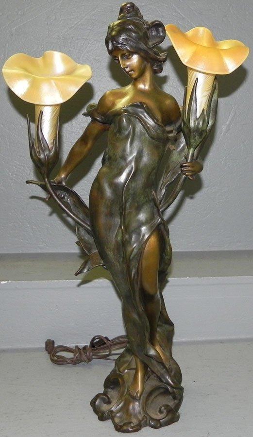 "Bronze and art glass lamp. 27"" tall."