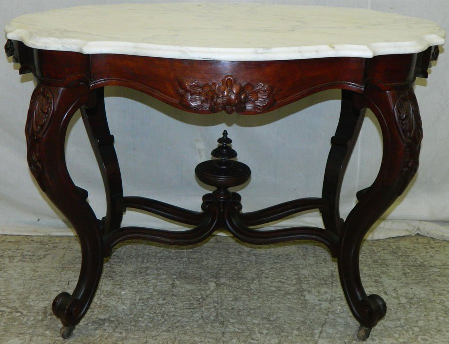 Mahogany turtle top carved base parlor table.