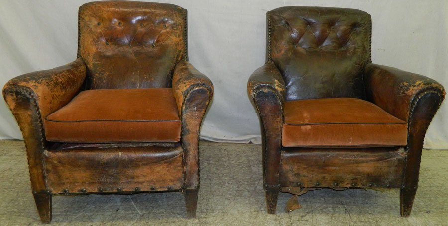 Pair of vintage leather arm chairs.