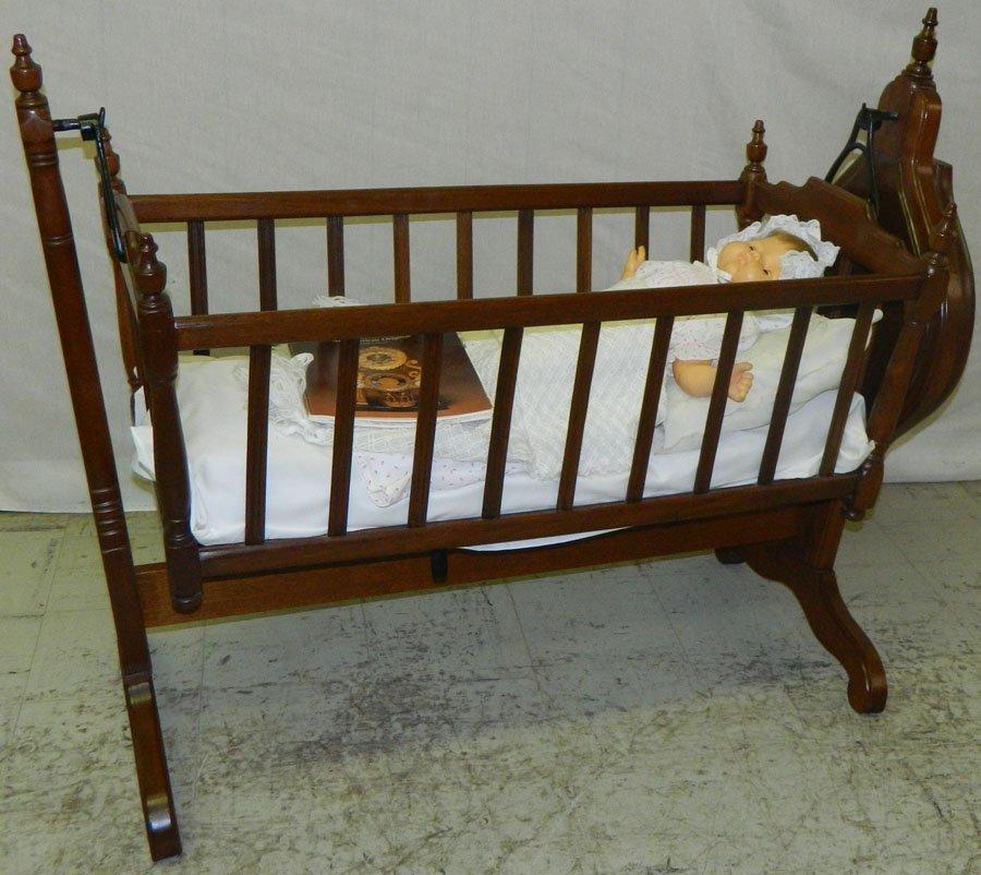 Victorian walnut mechanical baby cradle.