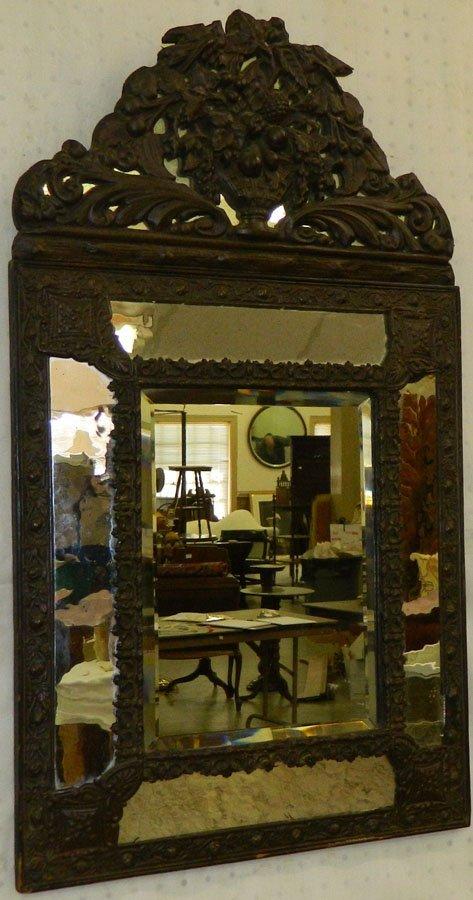 Early beveled edge brass mirror.