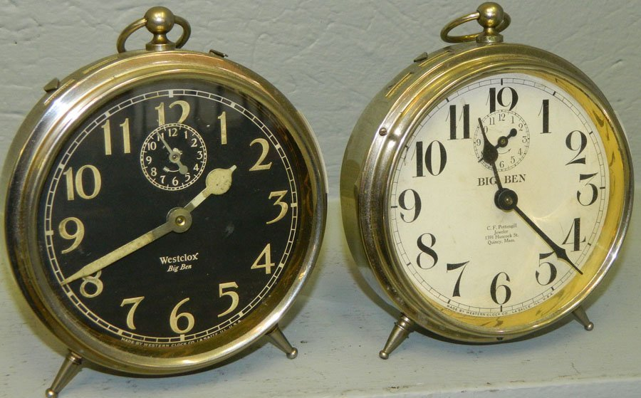 (2) Big Ben clocks. One with a black face.
