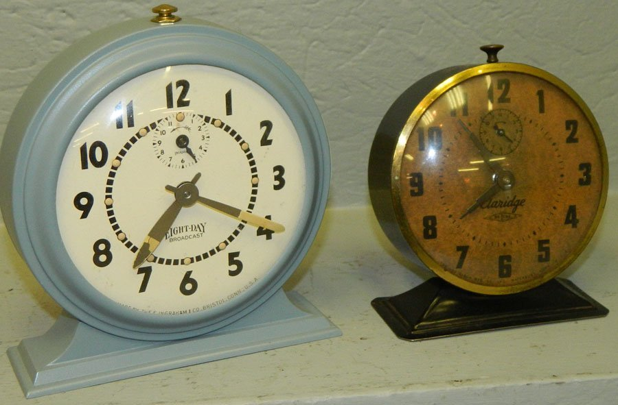 Eight day broadcast clock and a Claridge DeLux.