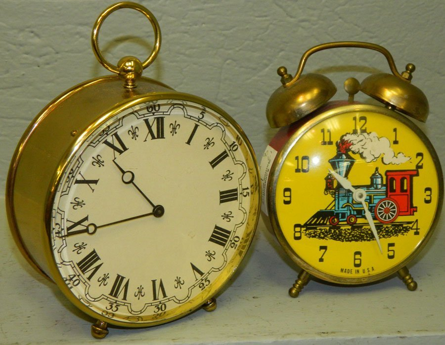 Eight day train face clock and a brass clock.