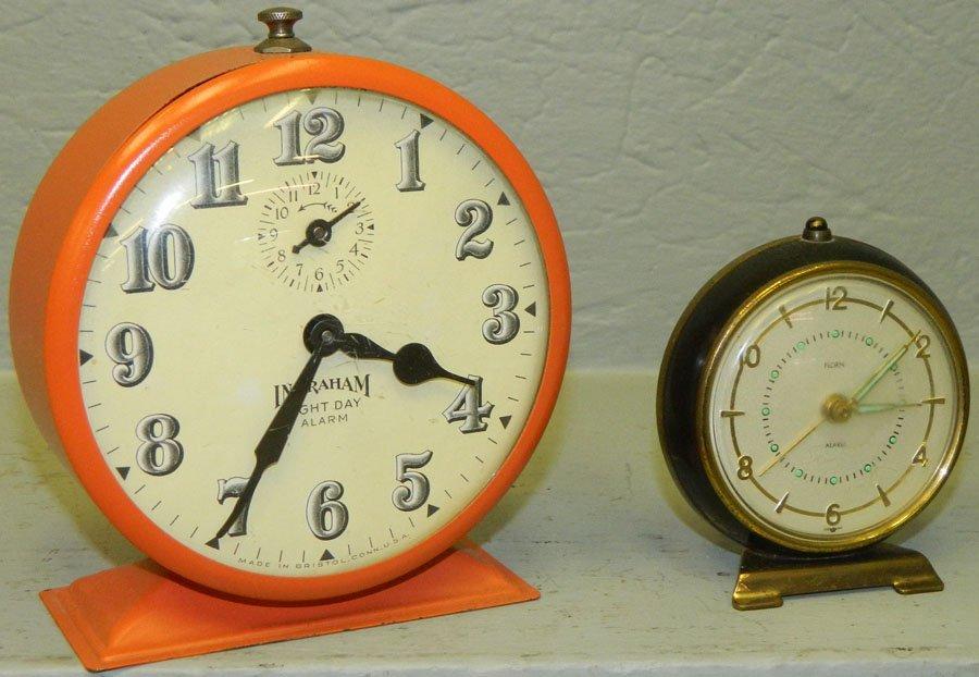 8 day alarm clock and a Florni German clock.