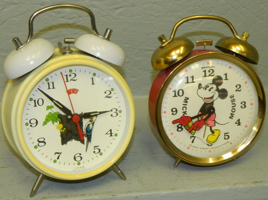 Mickey Mouse clock and Woodpecker clock.