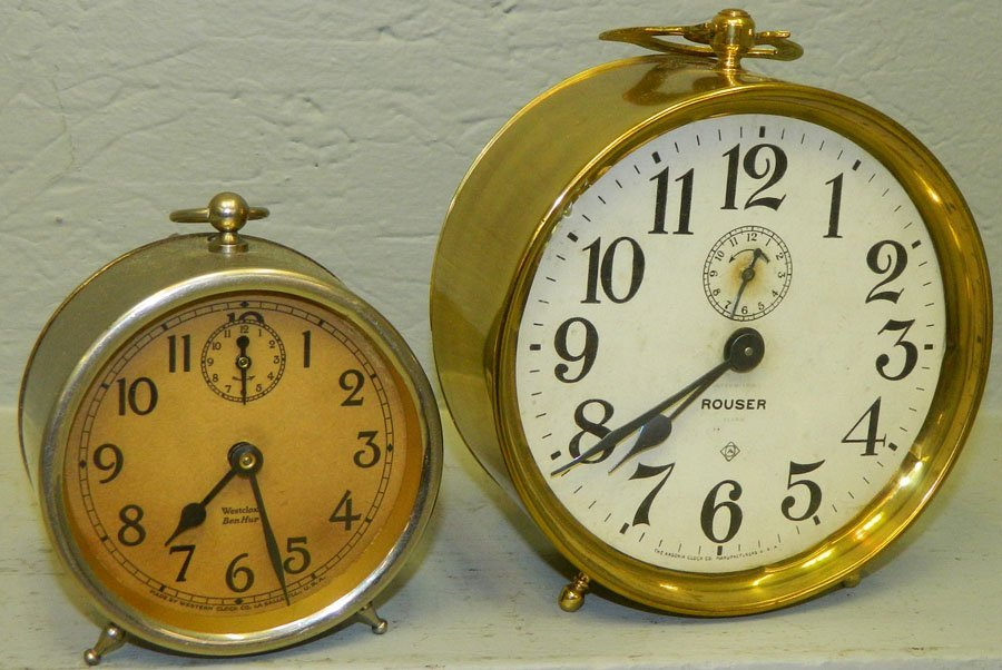 (1) Ansonia brass clock and (1) Ben Hur clock.