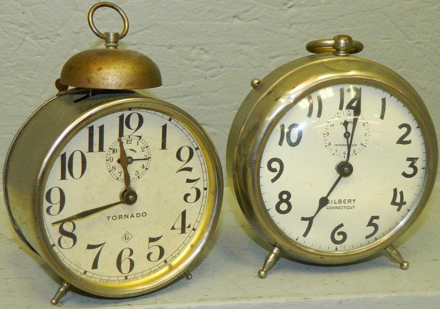 (2) Mechanical clocks w/ turning spinning wheel.