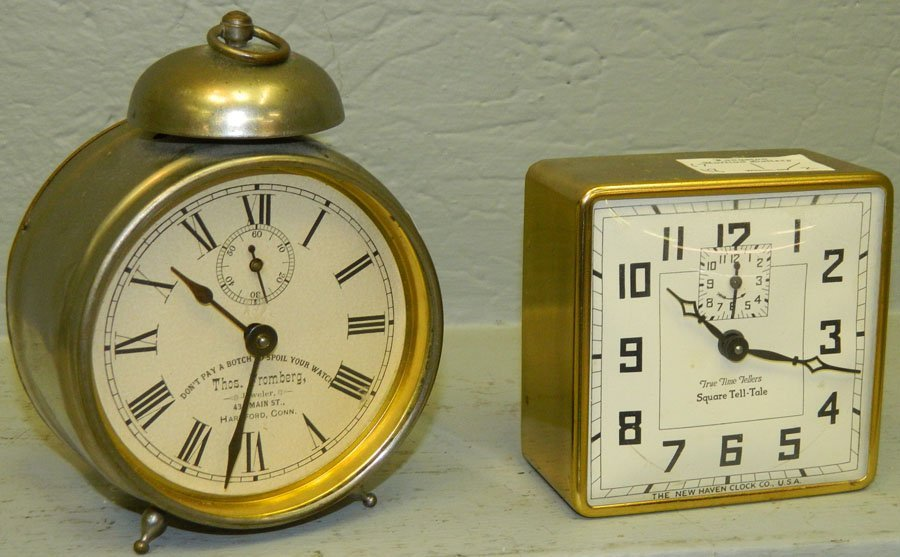 Square tale-tell clock and a Fromberg clock.