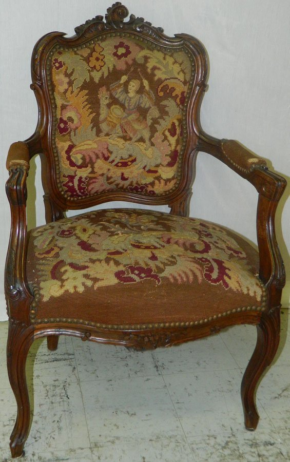 Needlepoint French carved walnut arm chair.