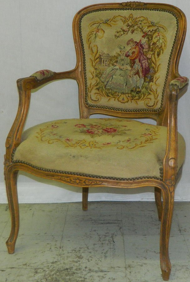 French fruitwood needlepoint arm chair.