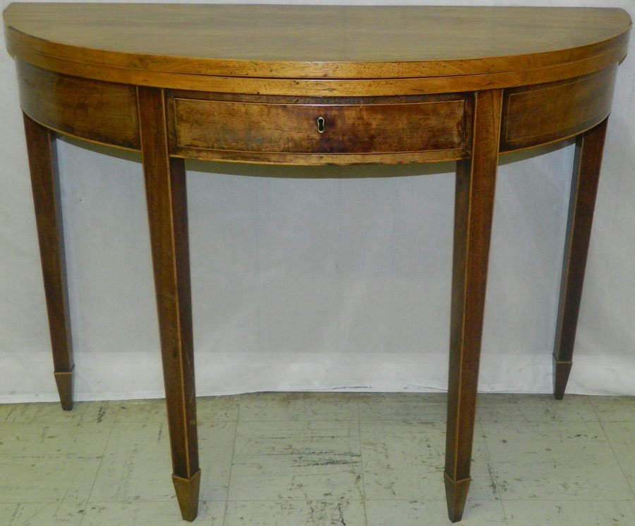 Period mahogany inlaid fold over game table.