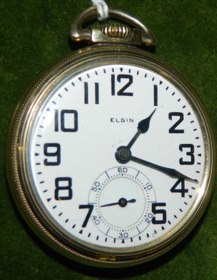 Pocket watch with faced marked Elgin.