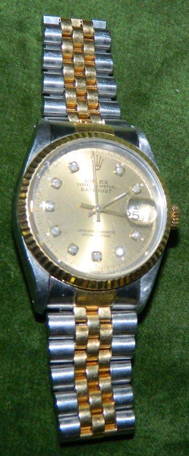 Rolex two-tone diamond quick set watch.