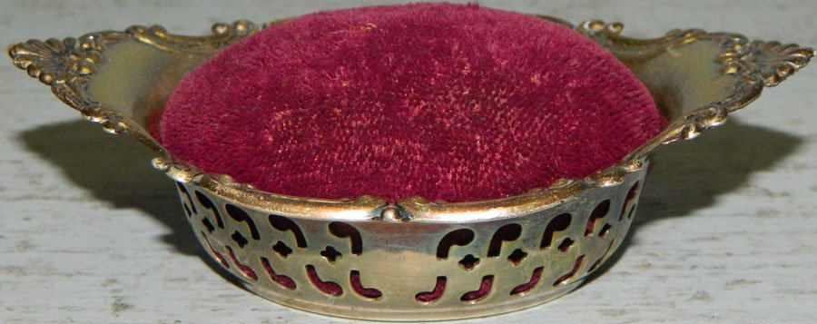 Sterling nut dish with pin cushion. .77 troy oz.