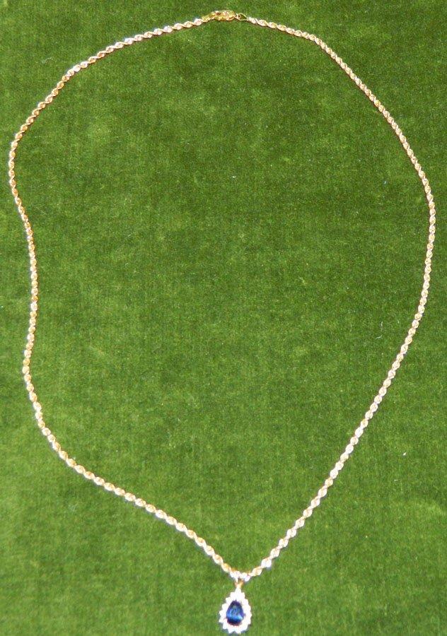 Lady's sapphire and diamond pendant.