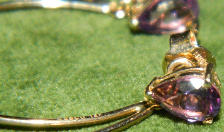 Pair of lady's amethyst stud earrings.