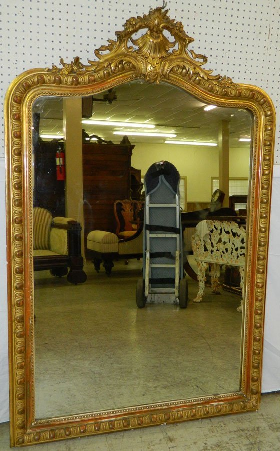 Large French mirror in Victorian gold leaf frame.