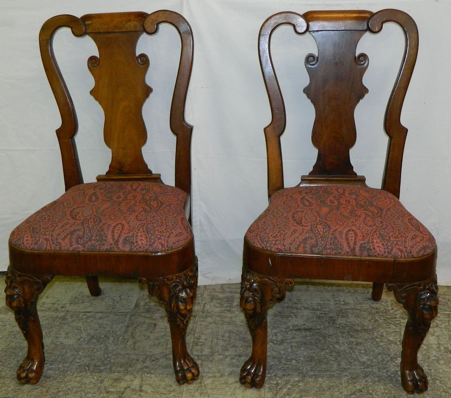 of Queen Anne lion claw foot chairs