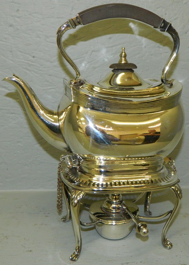 English silver plate Teapot on warming stand.