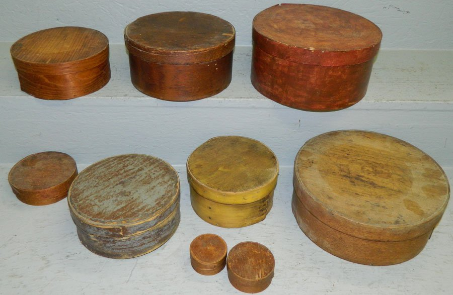 9 crafted wooden boxes with lids