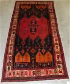 """10'6"""" x 5'1"""" antique Persian rug."""