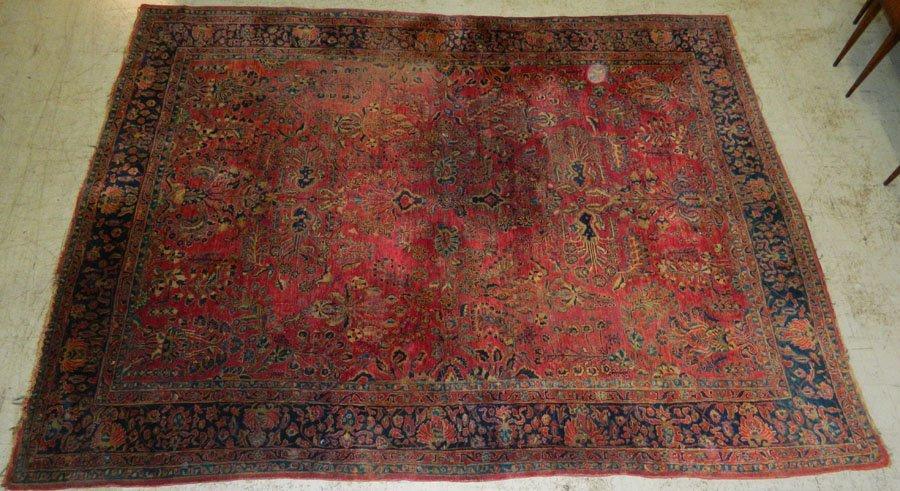 """12' x 9'4"""" Sarouk rug."""