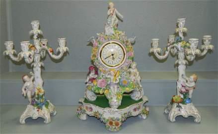 Remarkable Dresden clock and candelabras.