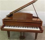 Mahogany Yamaha baby grand piano w/ stool.