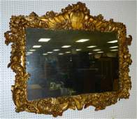 Gold leaf carved Della Robbia style framed mirror