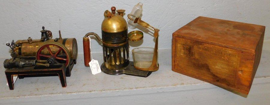 2 small antique steam engines.1 with original box.